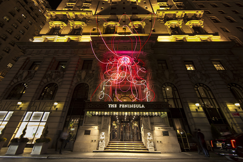 Grimanesa Amorós's Pink Lotus, 2015, a site specific installation on the façade of The Peninsula New York in honor of Breast Cancer Awareness month.