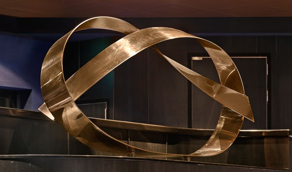 """Half Hitch Location: Norwegian Cruise Line, Escape, Theater Sculpture Size: 82""""X45""""X26"""" Material: Mirror Polished Bronze Comment: Mounted on black wood bases so that the audience passes each sculpture entering and leaving the state of the art theater on the 4,000 capacity new cruise ship."""