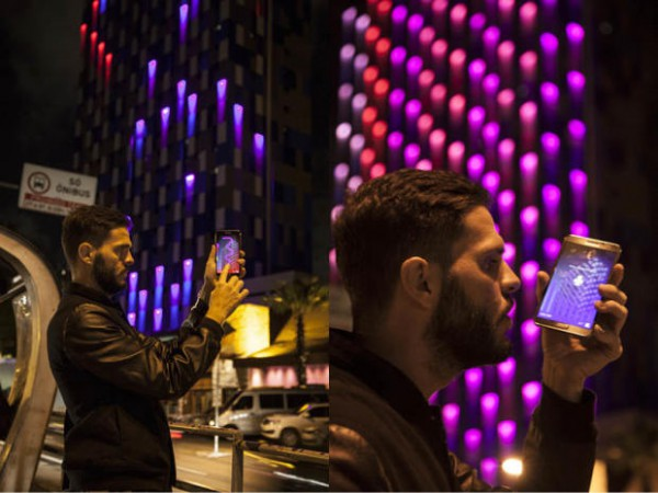 "Keynote Speaker Guto Requena's ""Light Creature"" allows viewers to interact with the building through a mobile app."