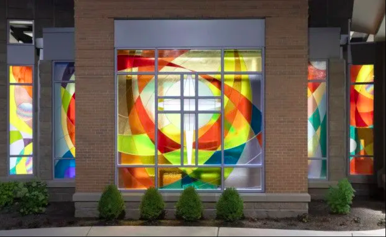 "Exterior of ""Poesis"", a series of stained glass windows designed by Judith Spater Canneto for Canneto Studio [photo credit: Andy Snow]"