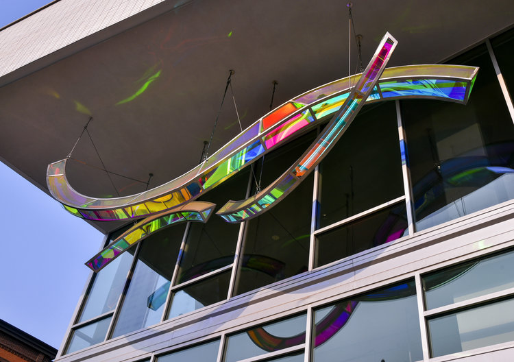 """""""Jubilation"""", North Shore Arts District, is made of three giant ribbons of stainless steel, dichrolaminated acrylic and lit from within by LEDs. [photo credit: Randal Schieber]"""