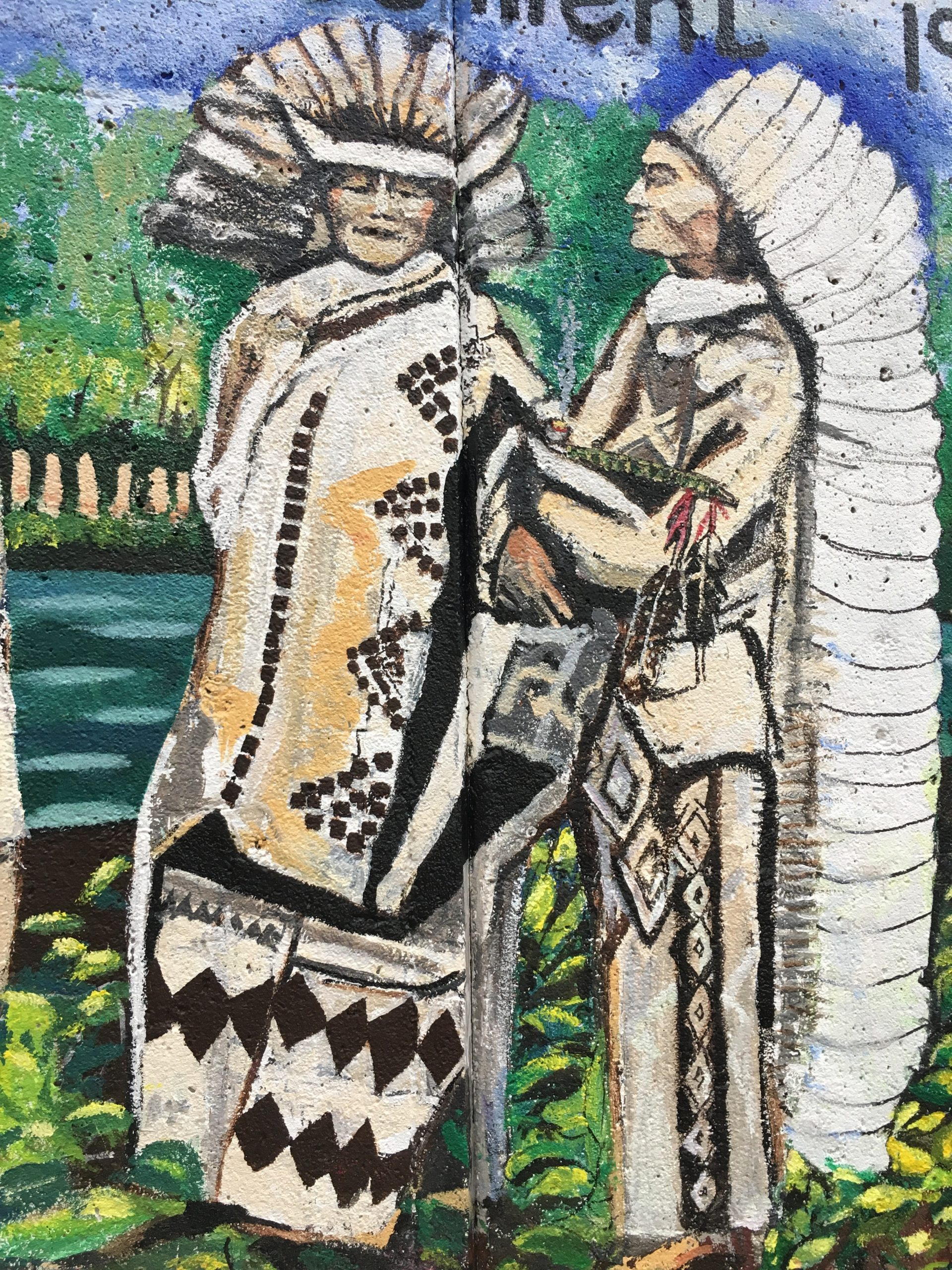 Cypress Street Land Acknowledgement Mural 2019  by Native American Wampanoag Artist  Deborah Spears Moorehead An  Outdoor Painted Mural on a Cement Bridge Wall  14 feet high by 30 feet wide